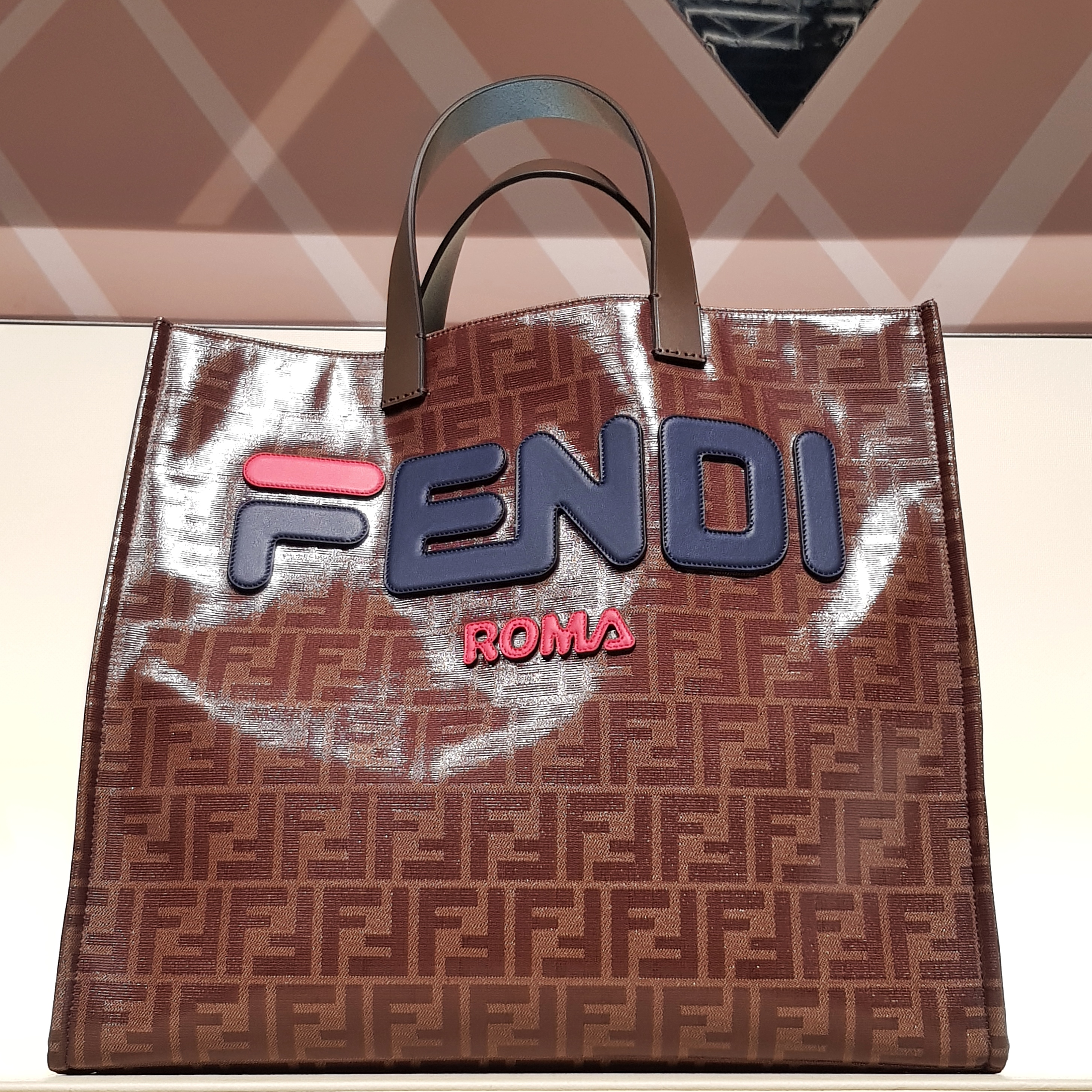 bfa19f3084 I thought there was a collaboration between Fendi and Fila LOL. The tote s  Fendi logo reminded me of Fila s logo!